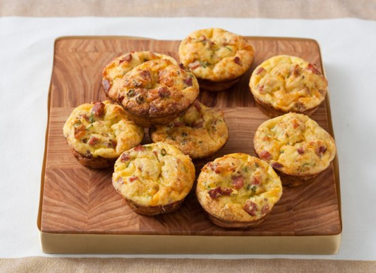 This recipe is based on a strata (an egg casserole), except it's made in a muffin tin to create individual servings. The egg-