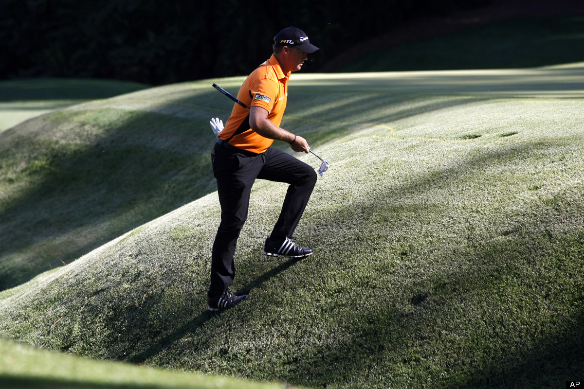 Peter Hanson climbs the hill to the 13th green during the third round of the Masters golf tournament at Augusta National Golf