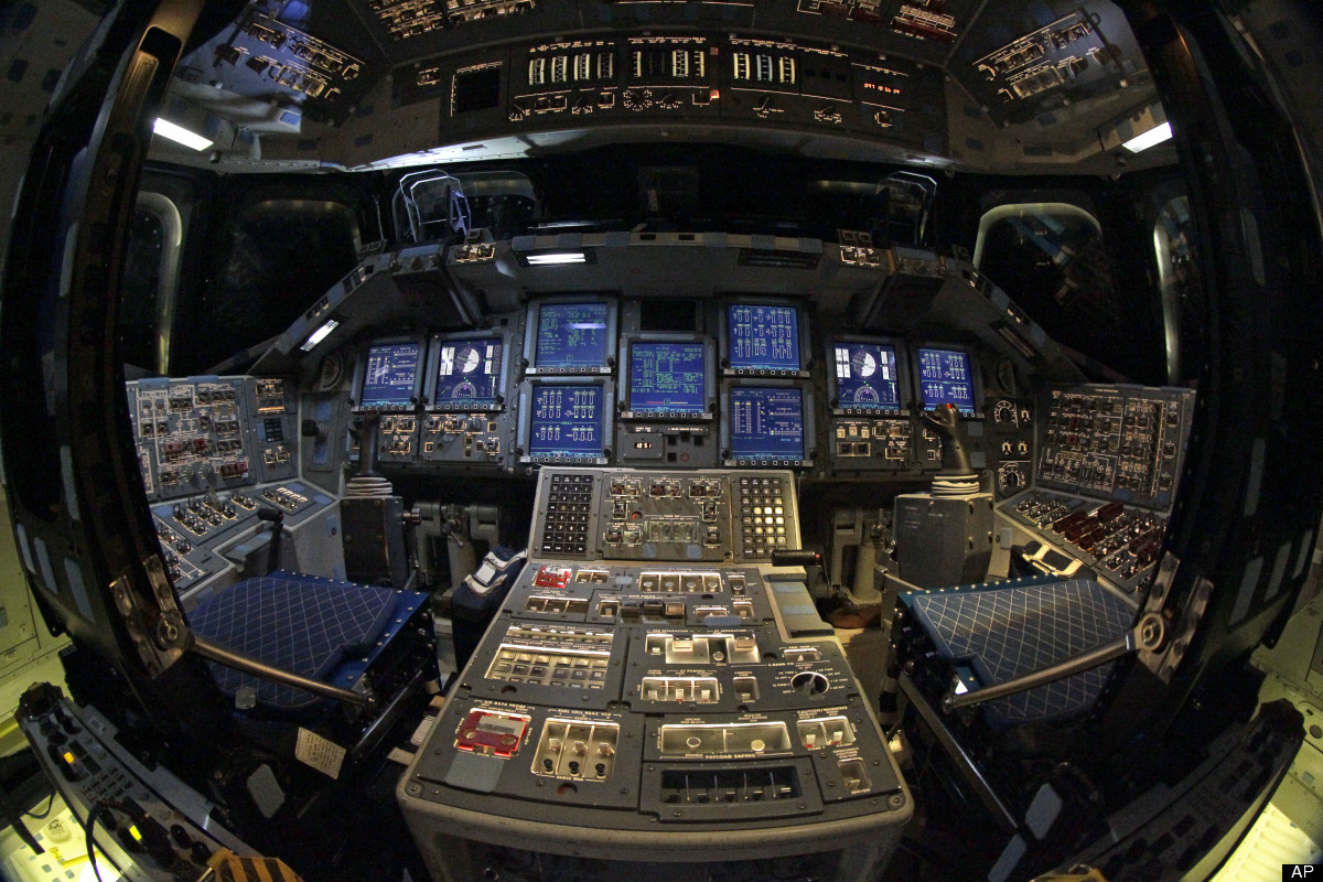 The cockpit of space shuttle Endeavour is seen during a media tour at Kennedy Space Center Friday, April 6, 2012, in Cape Can