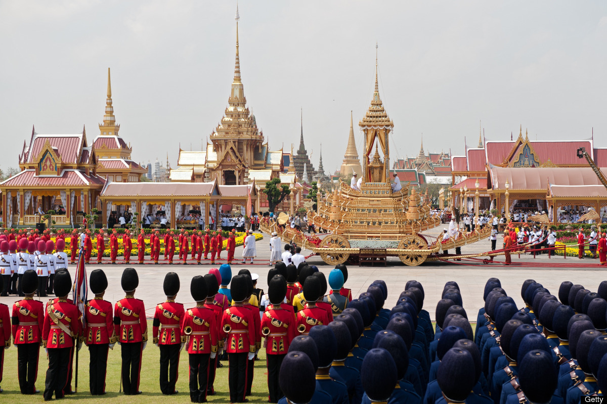 Thai soldiers dressed in ancient traditional uniforms pull the royal chariot carrying the royal urn of Thai Princess Bejarata