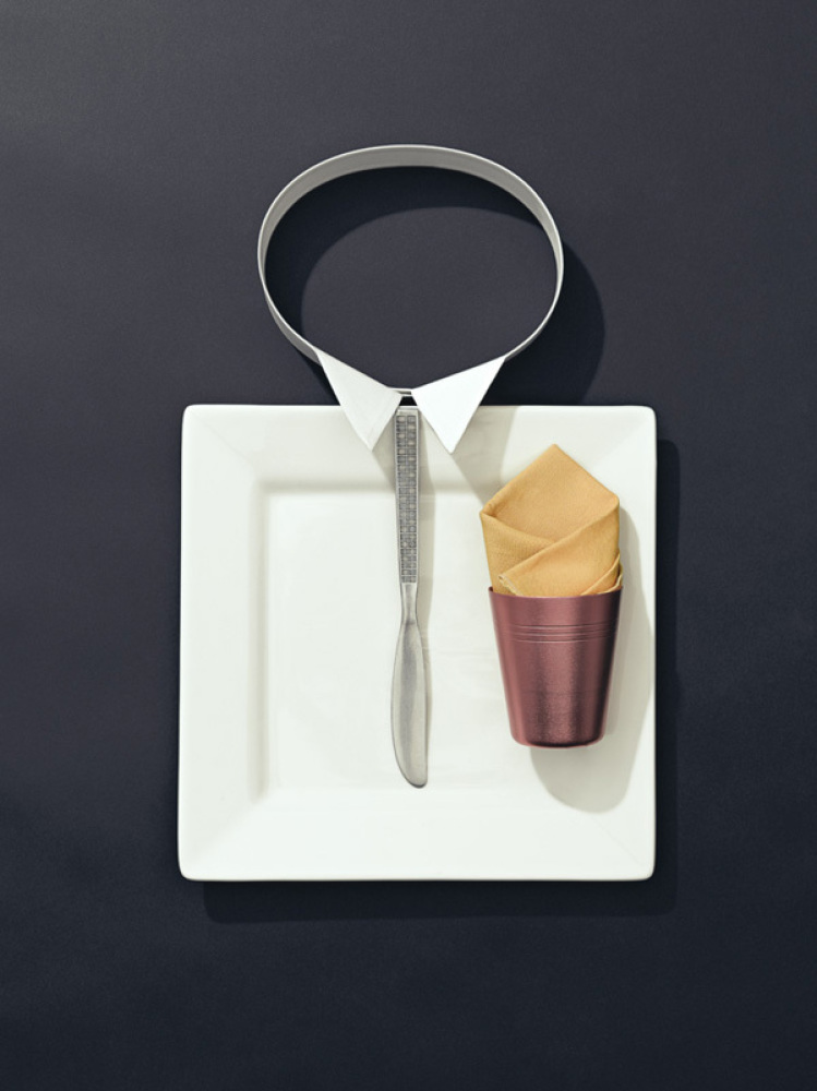 """With its slick butter knife tie and crisp collar, we can easily see why this Don Draper-inspired place setting is named """"Mad"""