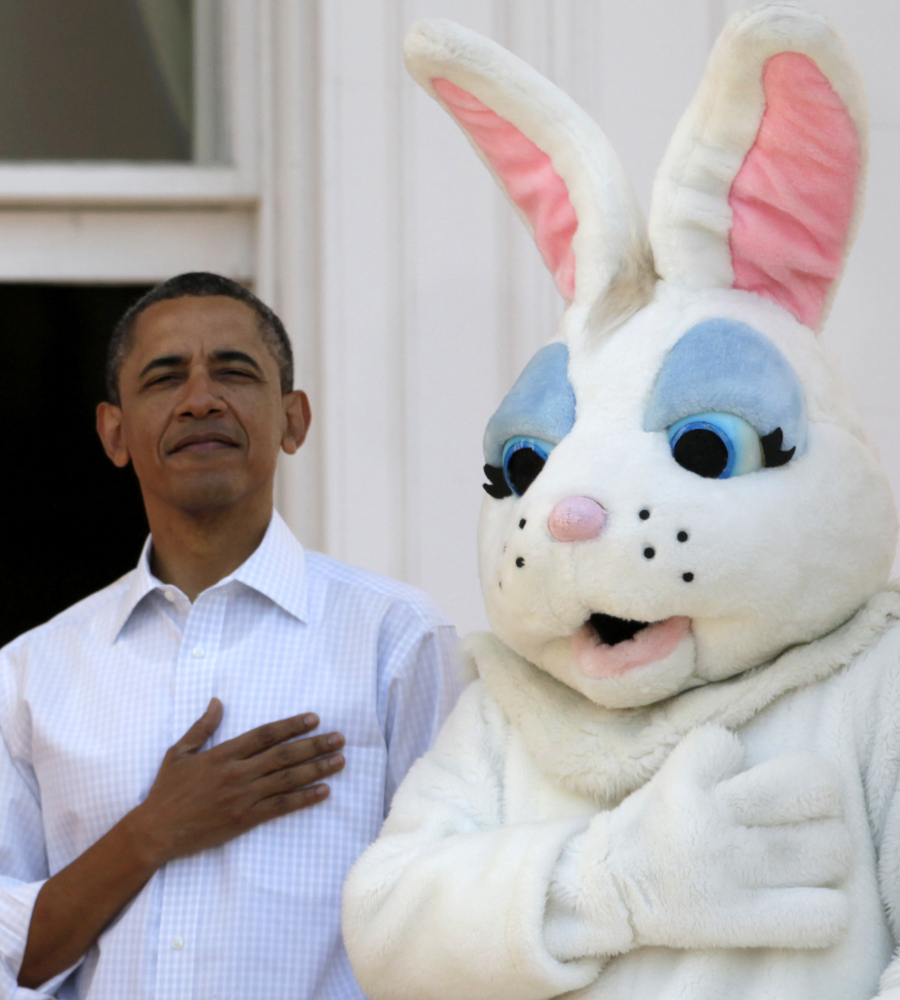 President Barack Obama stands next to the Easter Bunny during the singing of the National Anthem, at the White House in Washi