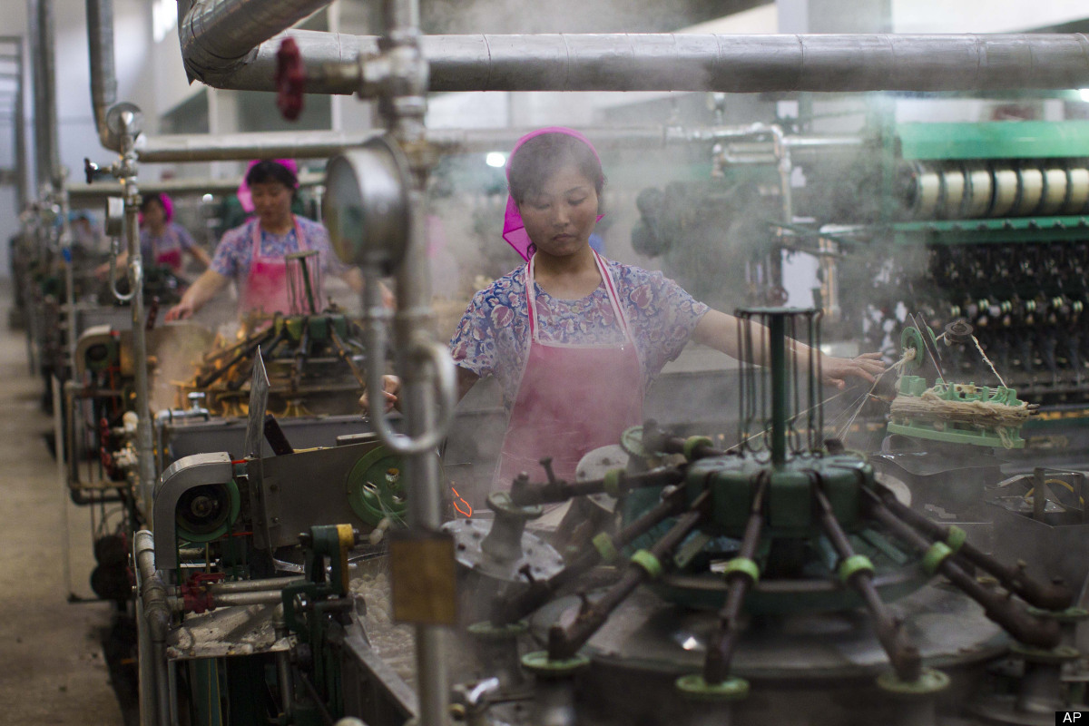 North Korean women work in a thread factory in Pyongyang, North Korea on Monday, April 9, 2012. (AP Photo/David Guttenfelder)
