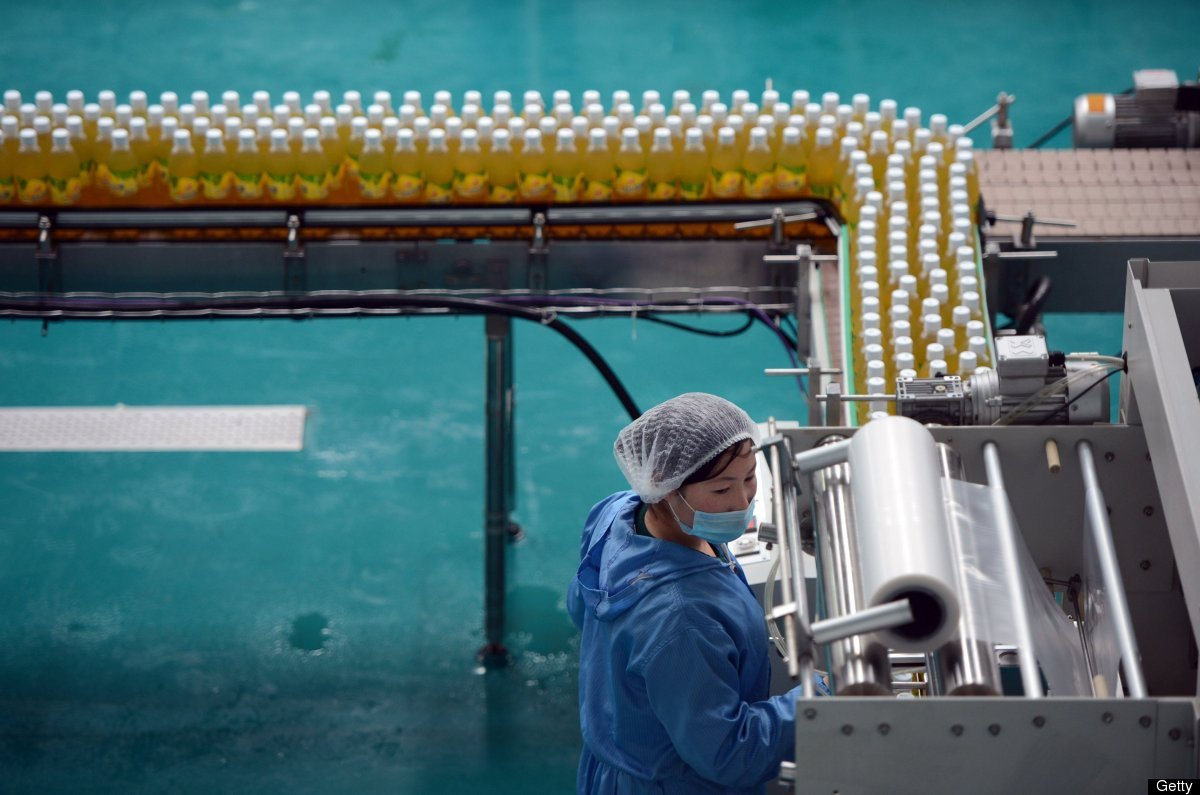 North Korean workers operate a fruit juice factory on the outskirts of Pyongyang on April 10, 2012. (PEDRO UGARTE/AFP/Getty I