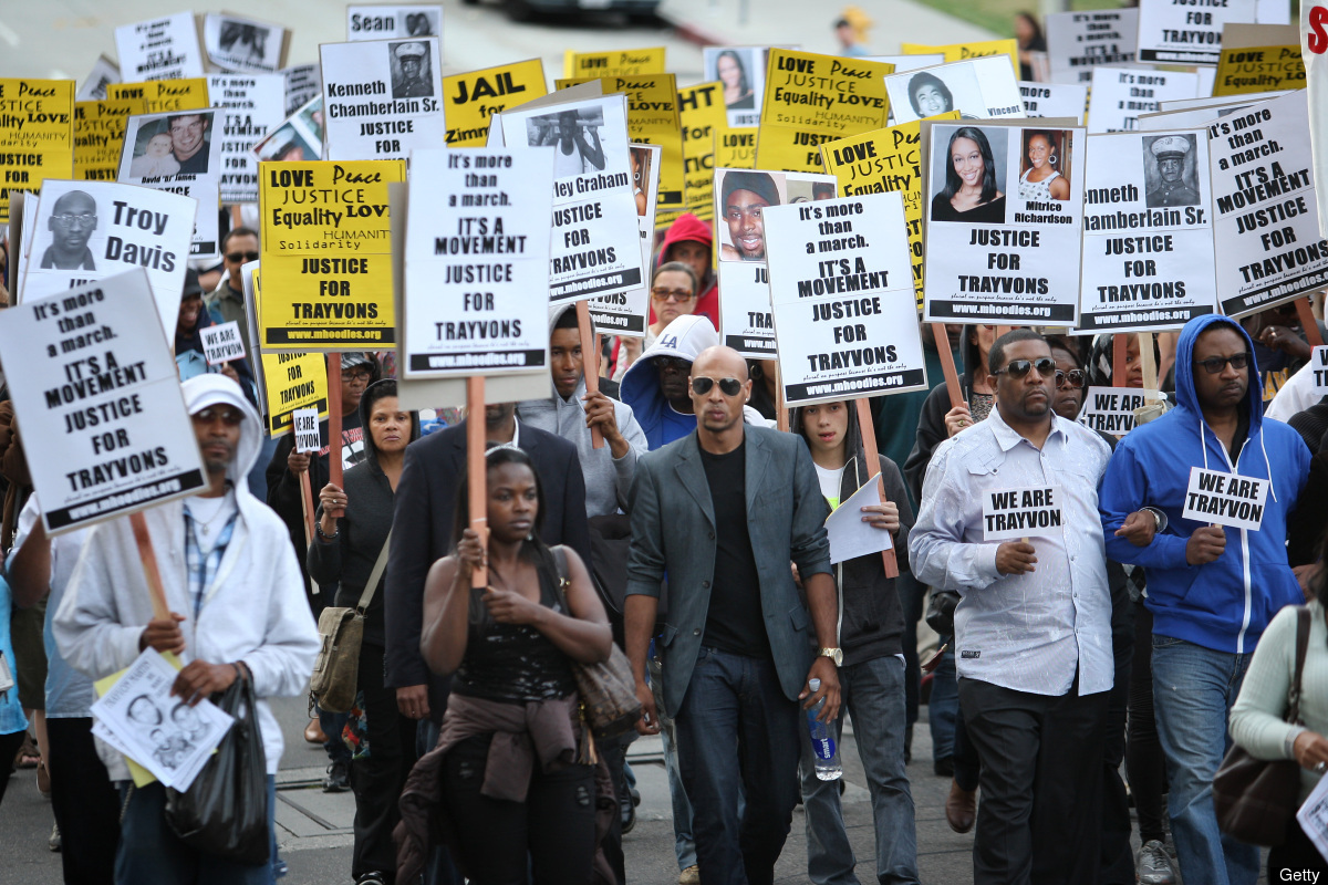 LOS ANGELES, CA - APRIL 9:  People walk in a silent protest march to demand justice for the shooting of Trayvon Martin, on Ap