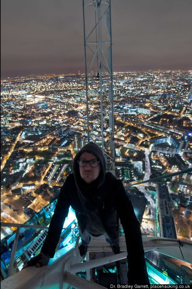 "Dr. Bradley Garrett covertly climbs to the top of the Shard in London. Credit: Dr. Bradley Garrett, <a href=""http://www.place"