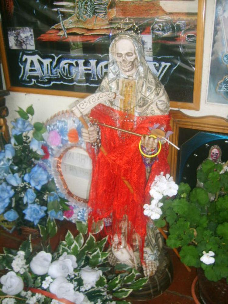 Cloaked in dollars, Santa Muerte shrine in Santa Ana Chapitiro, Michoacan.