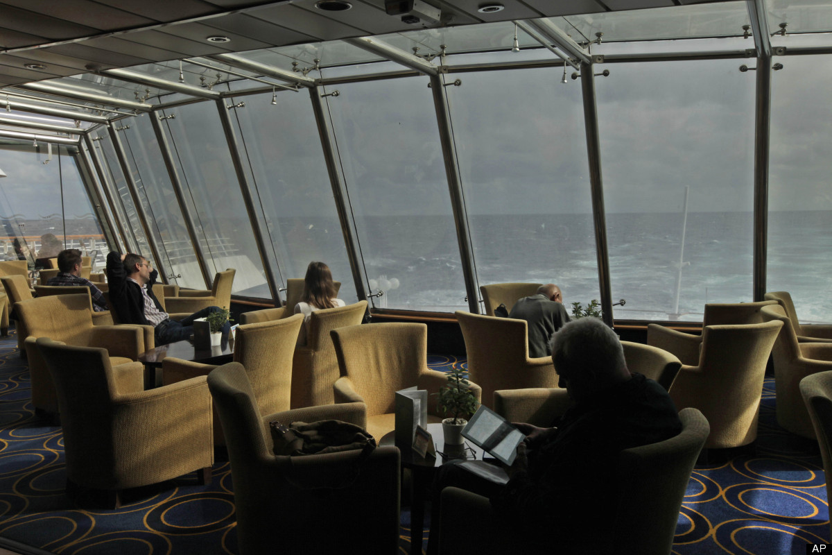Passengers pass time onboard the MS Balmoral Titanic memorial cruise ship, in the Atlantic Ocean, Wednesday, April 11, 2012.