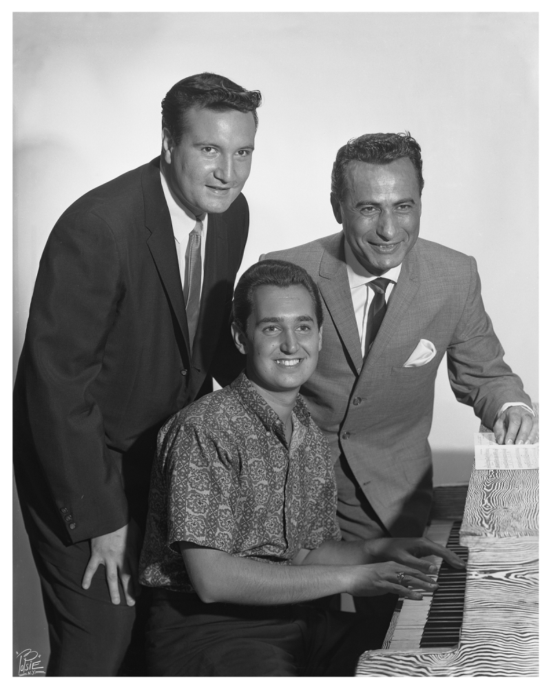 """Kirshner and his partner, Al Nevins, congratulate Neil Sedaka after his first hit, """"The Diary,"""" in 1959."""