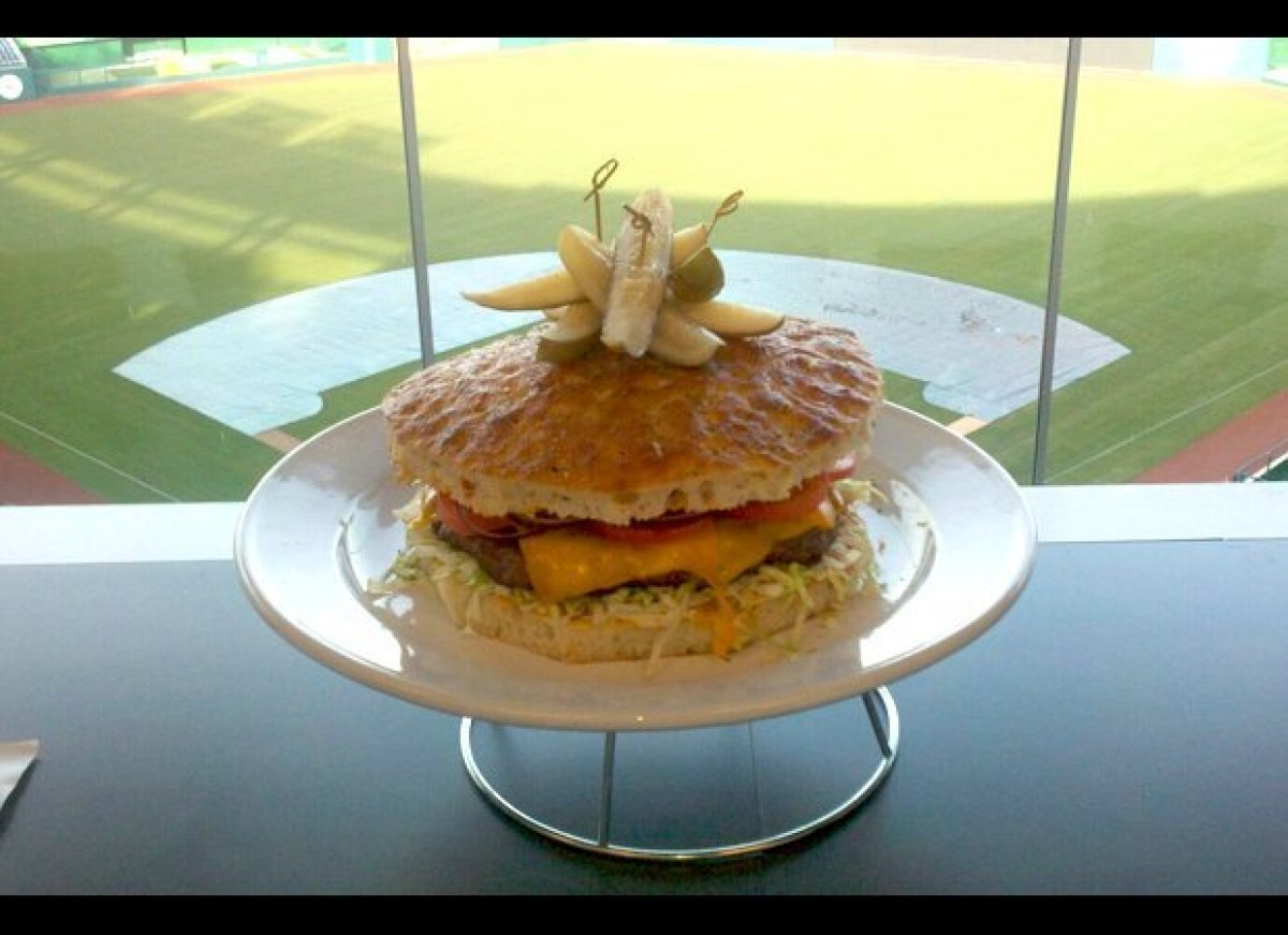 "Named after their pitcher Stephen Strasburg, the Nationals Park's ""Strasburger"" is an 8-pound feat of a burger. It is an all-"