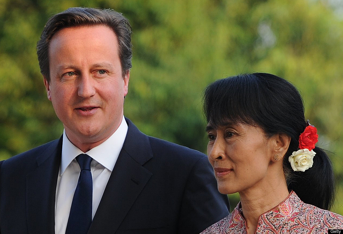 British Prime Minister David Cameron (L) talks with Myanmar opposition leader Aung San Suu Kyi after their meeting at Suu Kyi