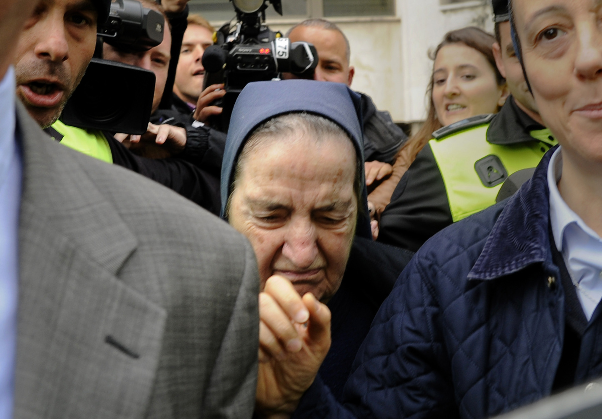 Spanish nun Maria Gomez Valbuena (C) leaves a court in Madrid on April 12, 2012 after refusing to testify before the judge fo