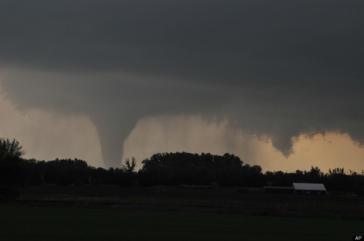 <em>From AP:</em> A tornado moves on the ground north of Solomon, Kan., on Saturday evening, April 14, 2012, with I-70 seen i
