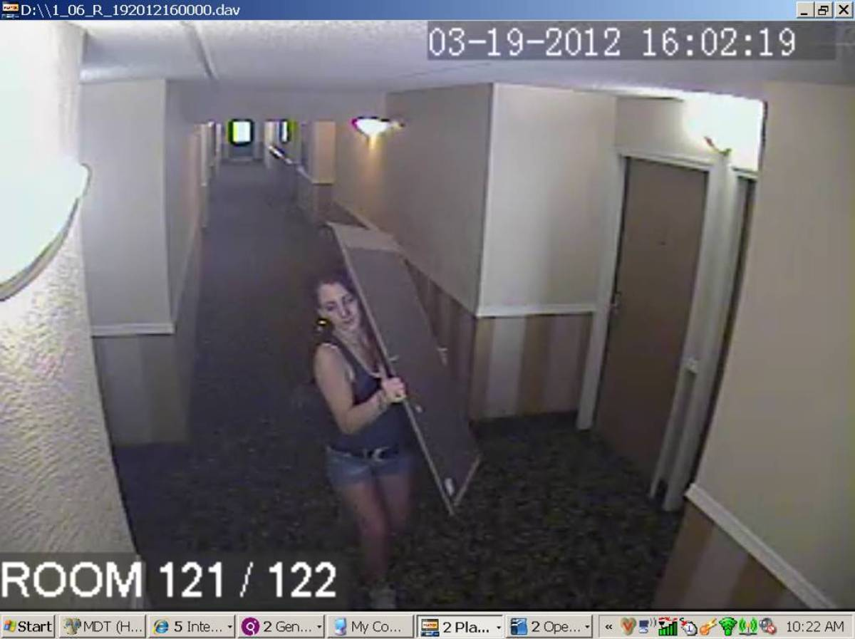 Police are looking for this woman seen stealing from a hotel room in the Sabal Suites in Tampa, Fla. on March 21.