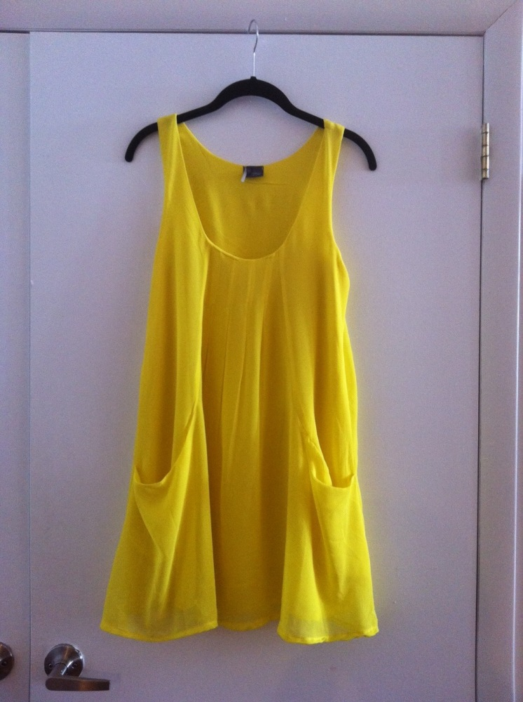 """""""I briefly contemplated getting this dress in a more practical black, but then steered back to neon yellow. No regrets."""" - St"""