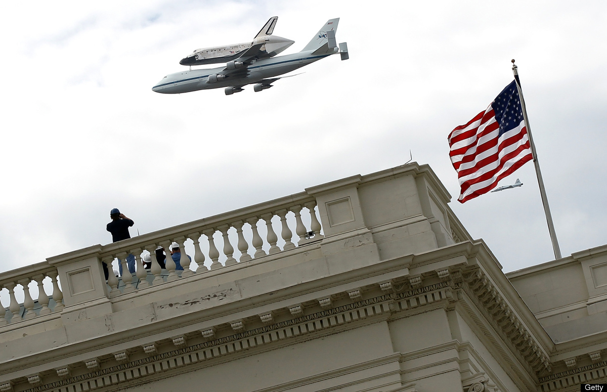Space Shuttle Discovery, mounted atop a 747 shuttle carrier aircraft, flies over the U.S. Capitol during a flyover of the nat