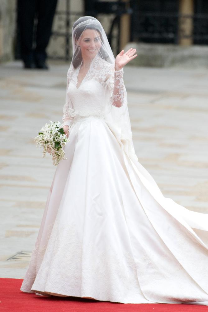"Kate Middleton wore a custom made <a href=""http://www.huffingtonpost.com/2011/04/29/sarah-burton-kate-middleton-wedding-dress"