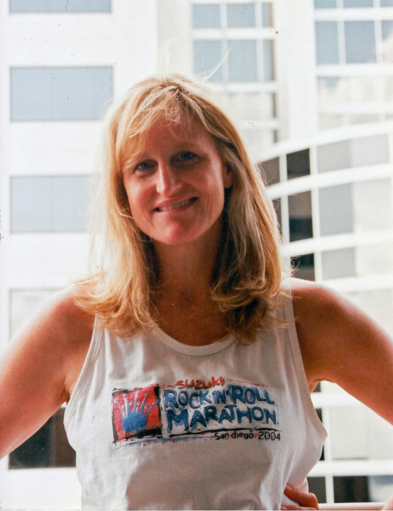Margaret has run six marathons since taking her first step towards a more adventurous life. Here she is in 2004, at the Rock