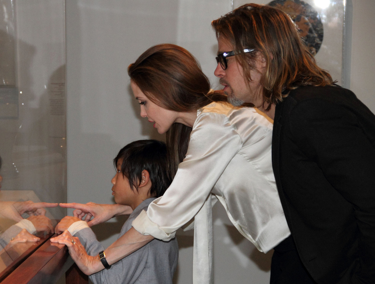 """Photos of Brad Pitt and Angelina Jolie's """"wedding of the century"""" is expected to rake in $2 million for paparazzi photos of t"""