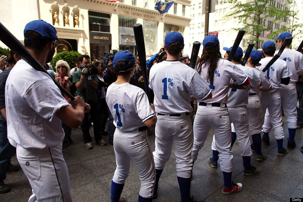 NEW YORK, NY - APRIL 17:  Dressed in 'Tax Dodgers' uniforms, people associated with Occupied Wall Street participate in a ser