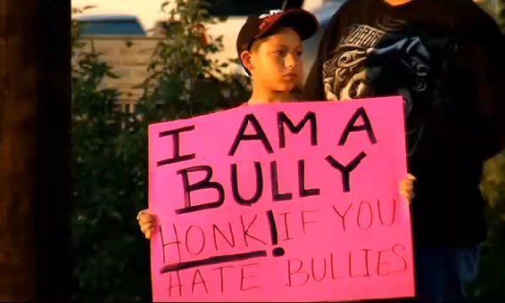 "Jose Lagares made his fourth-grade son hold a large homemade sign that read: ""I am a bully. Honk if you hate bullies.""  <a hr"