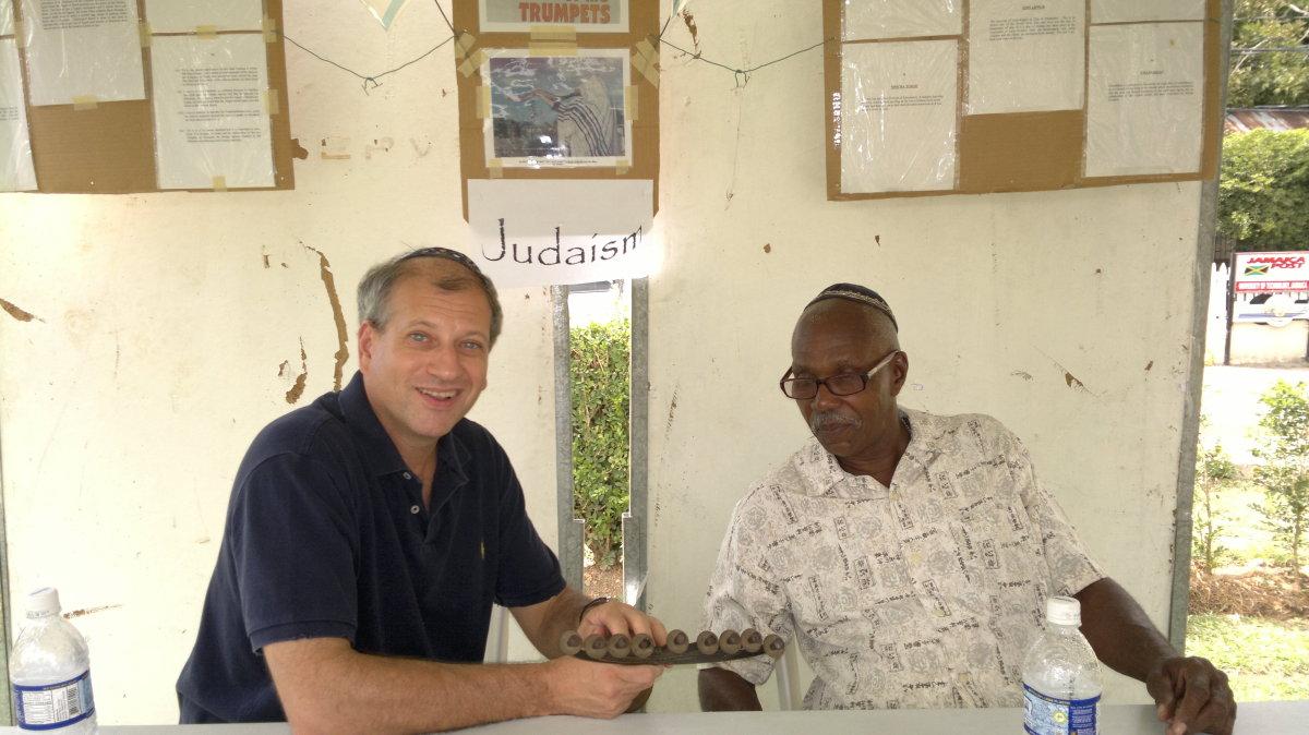 Rabbi Kaplan discusses Judaism at an interfaith fair at University of Technology, Jamaica.