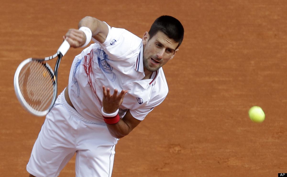 Novak Djokovic of Serbia serves the ball to Ukraine's Alexandr Dolgopolov during their match of the Monte Carlo Tennis Master