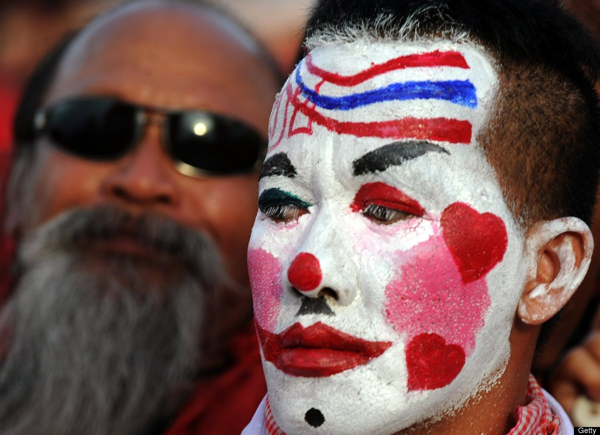 A 'Red Shirt' supporter of Thailand's fugitive former premier Thaksin Shinawatra sports a painted face during a rally in Siem