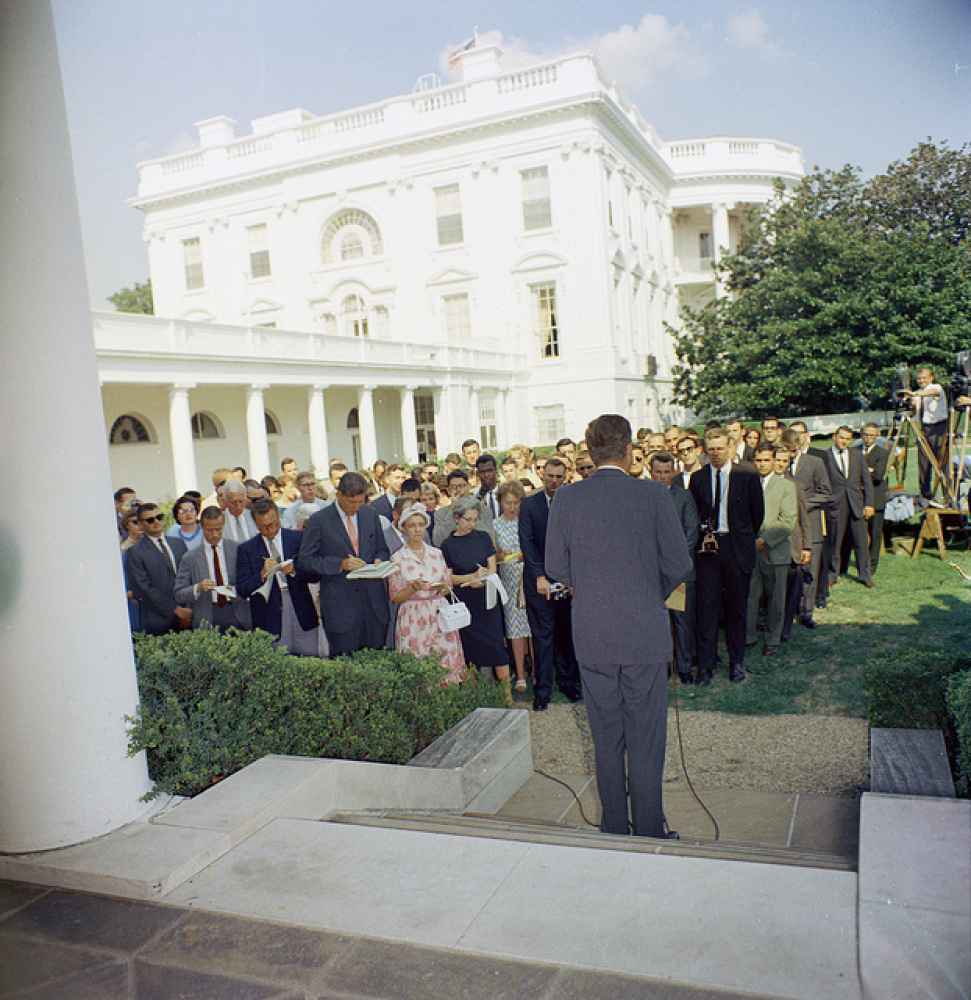 President John F. Kennedy addresses Peace Corps Volunteers during a ceremony for the first group of departing volunteers, lea