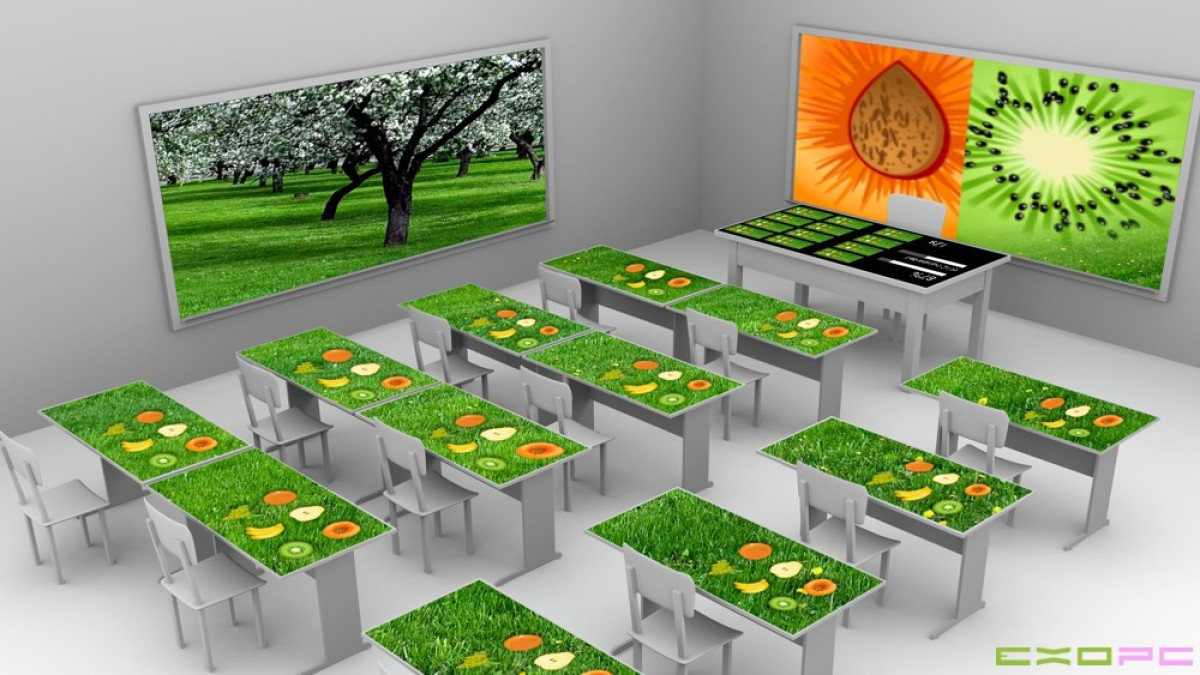 In the EXO classroom, each desk shares cables with another one to reduce power consumption.  (Image courtesy of ExoPC)