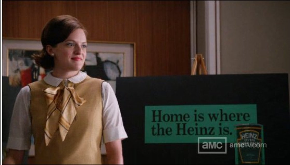 """Peggy's bow: Lovely, but a little too 'young' for a pitch meeting.  <a href=""""http://www.amctv.com/shows/mad-men"""" target=""""_h"""