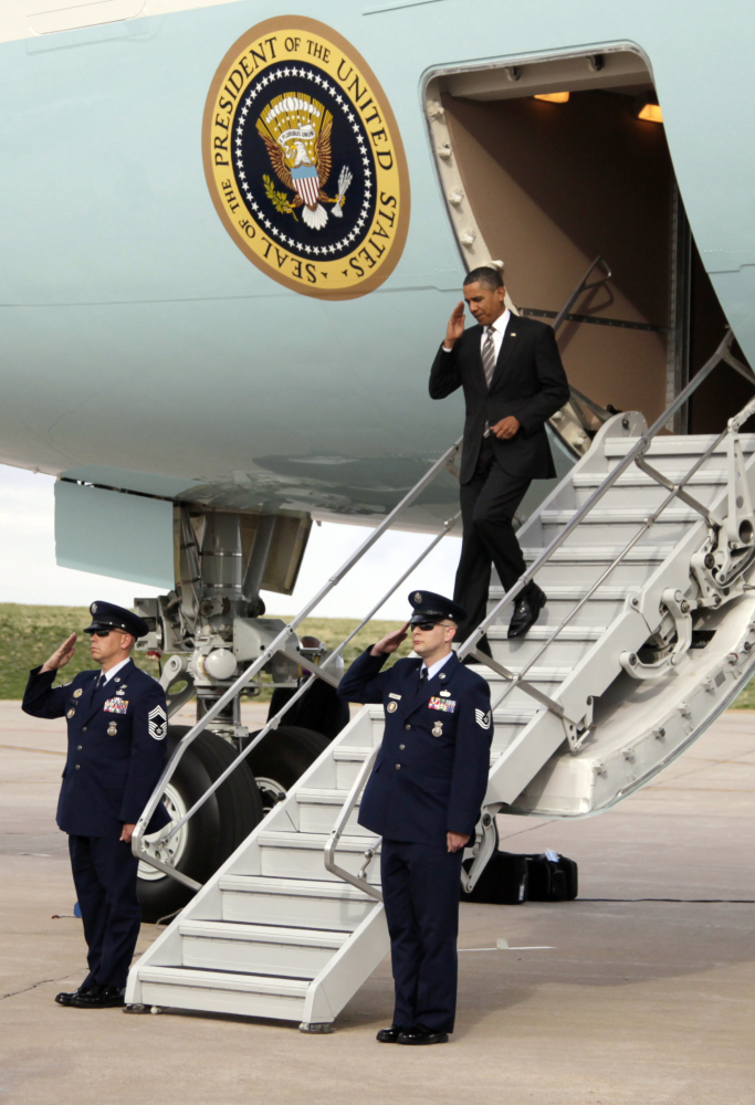 President Barack Obama steps off of Air Force One as he arrives at at Buckley Air Force Base, Tuesday, April 24, 2012, in Aur