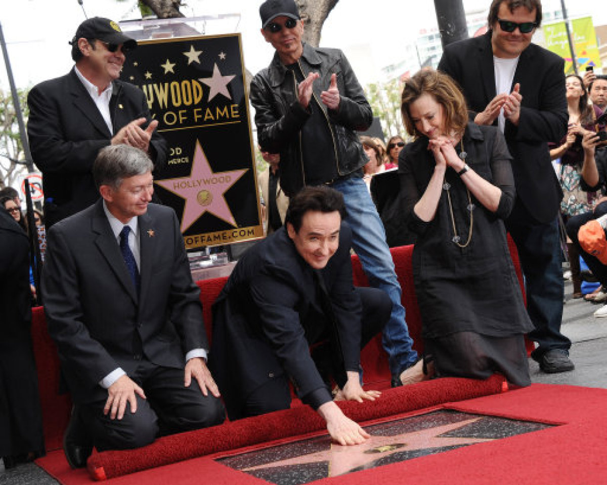 John Cusack is given his star on Hollywood's Walk of Fame, with famous friends in support. Pictures: PA