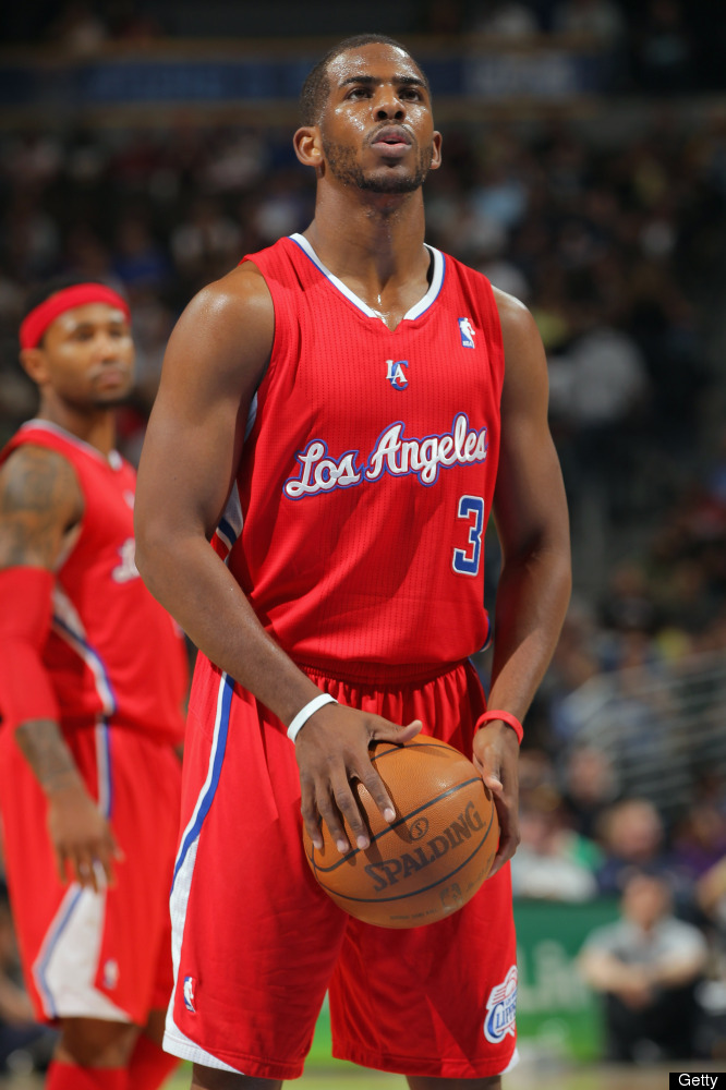 Chris Paul takes a free throw against the Denver Nuggets at Pepsi Center on April 18, 2012 in Denver, Colorado. The Clippers