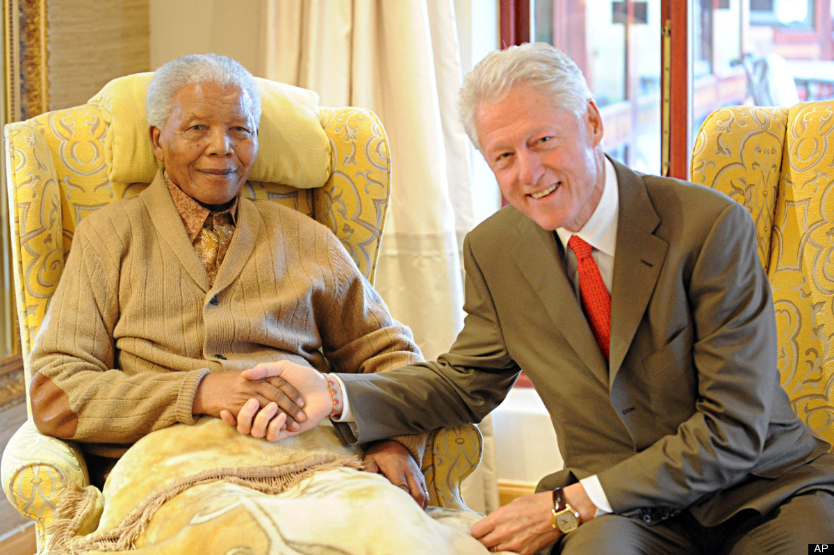 Former US President, Bill Clinton, right, meets with former South African President Nelson Mandela at his home in Qunu, South