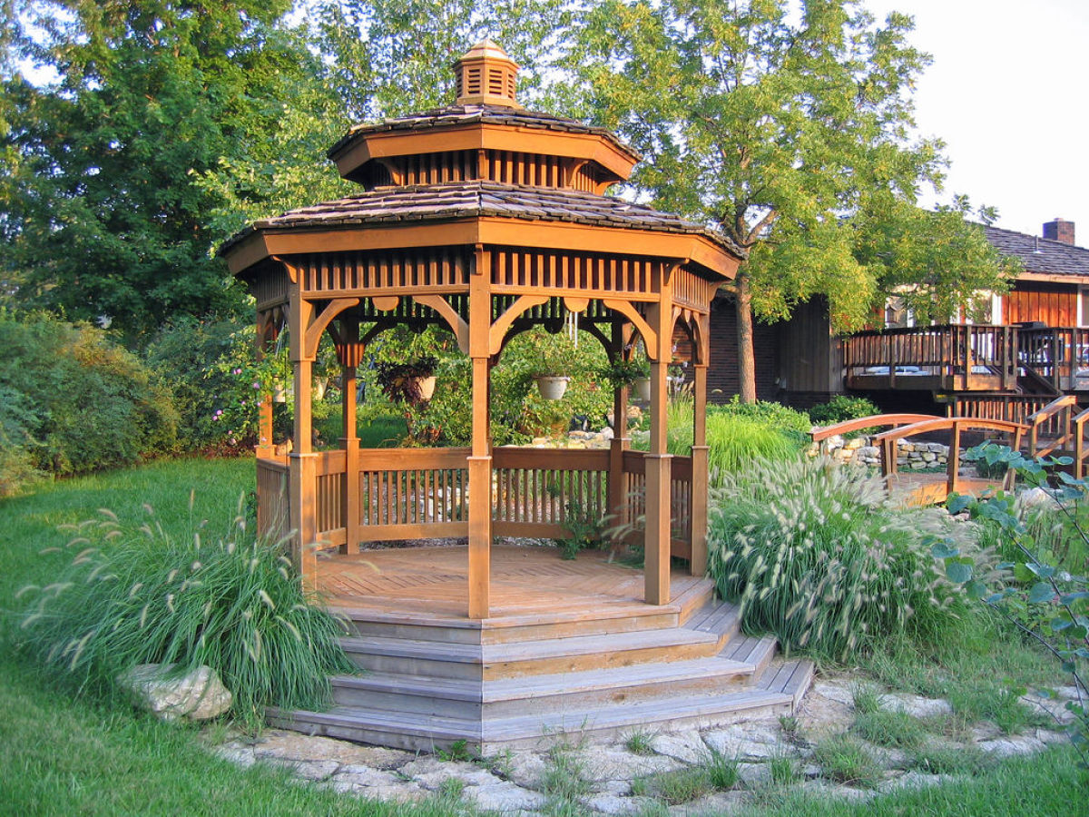 Lush Flower Bushes Are All You Need To Turn A Wooden Gazebo Into A Relaxing  Oasis