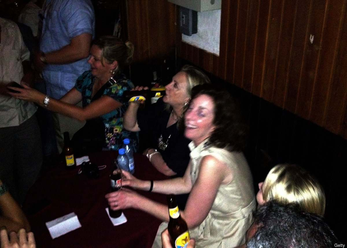 US Secretary of State Hillary Clinton enjoys a relax momment at Cafe Havana in Cartagena, Colombia on April 15, 2012. Clinton