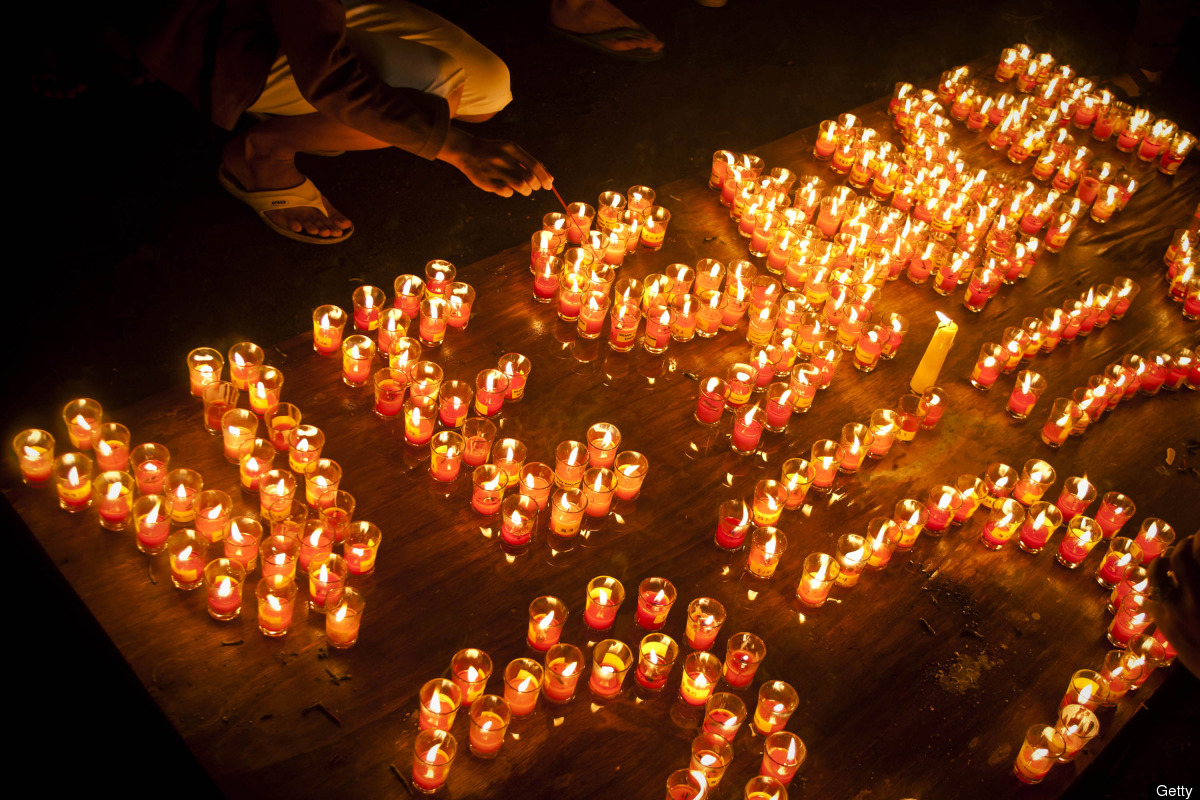 """Buddhist followers lighting candles at Borobudur temple during Vesak Day, commonly known as """"Buddha's birthday,"""" at the Borob"""