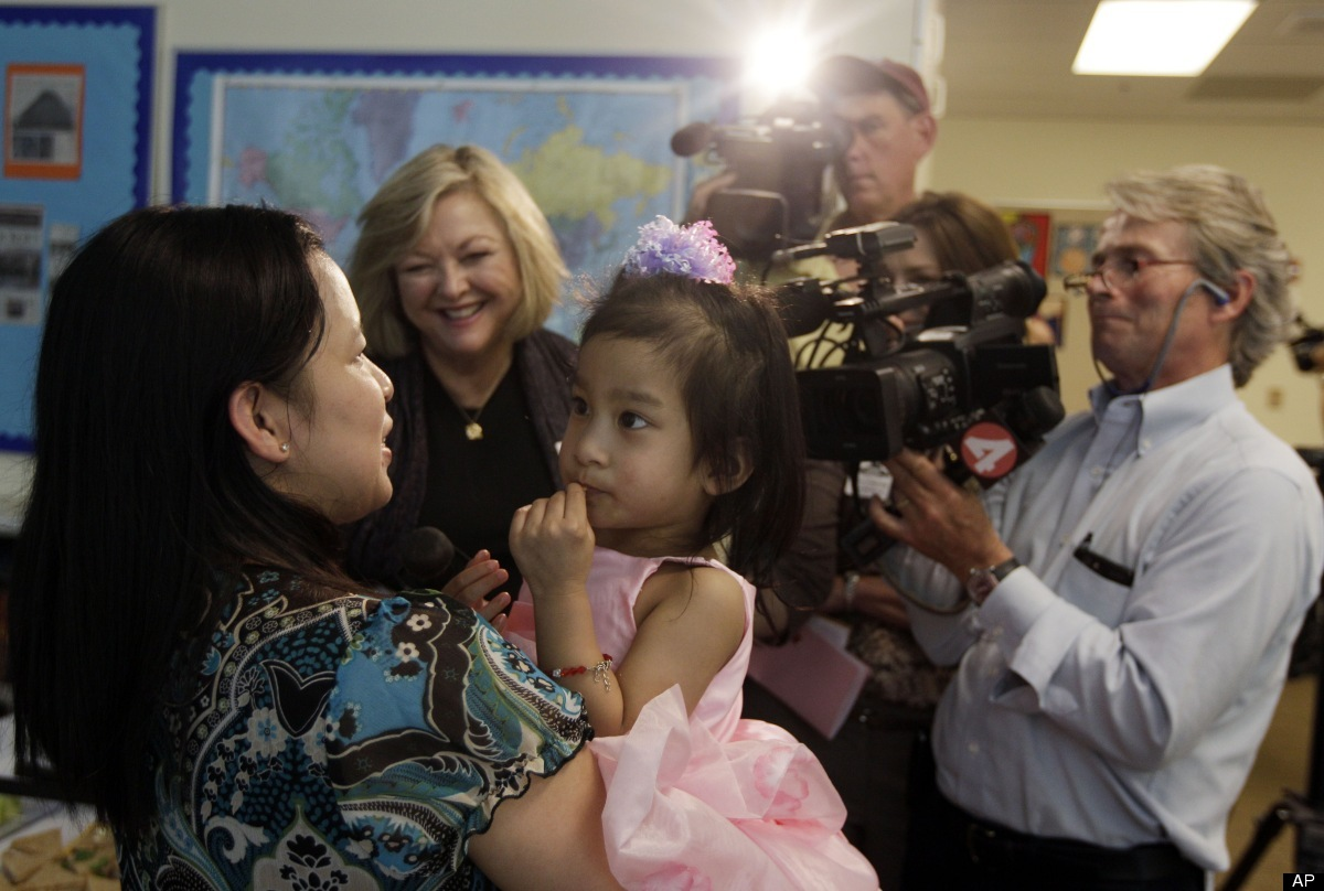 Angelica Sabuco, 2, is held by her mom Ginady as members of the press ask questions at Lucile Packard Children's Hospital Mon