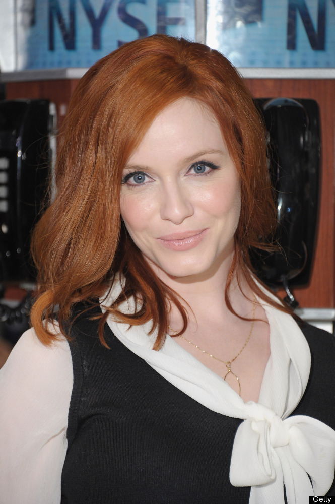 Actress Christina Hendricks poses after ringing the opening bell with the cast of 'Madmen' at the New York Stock Exchange on