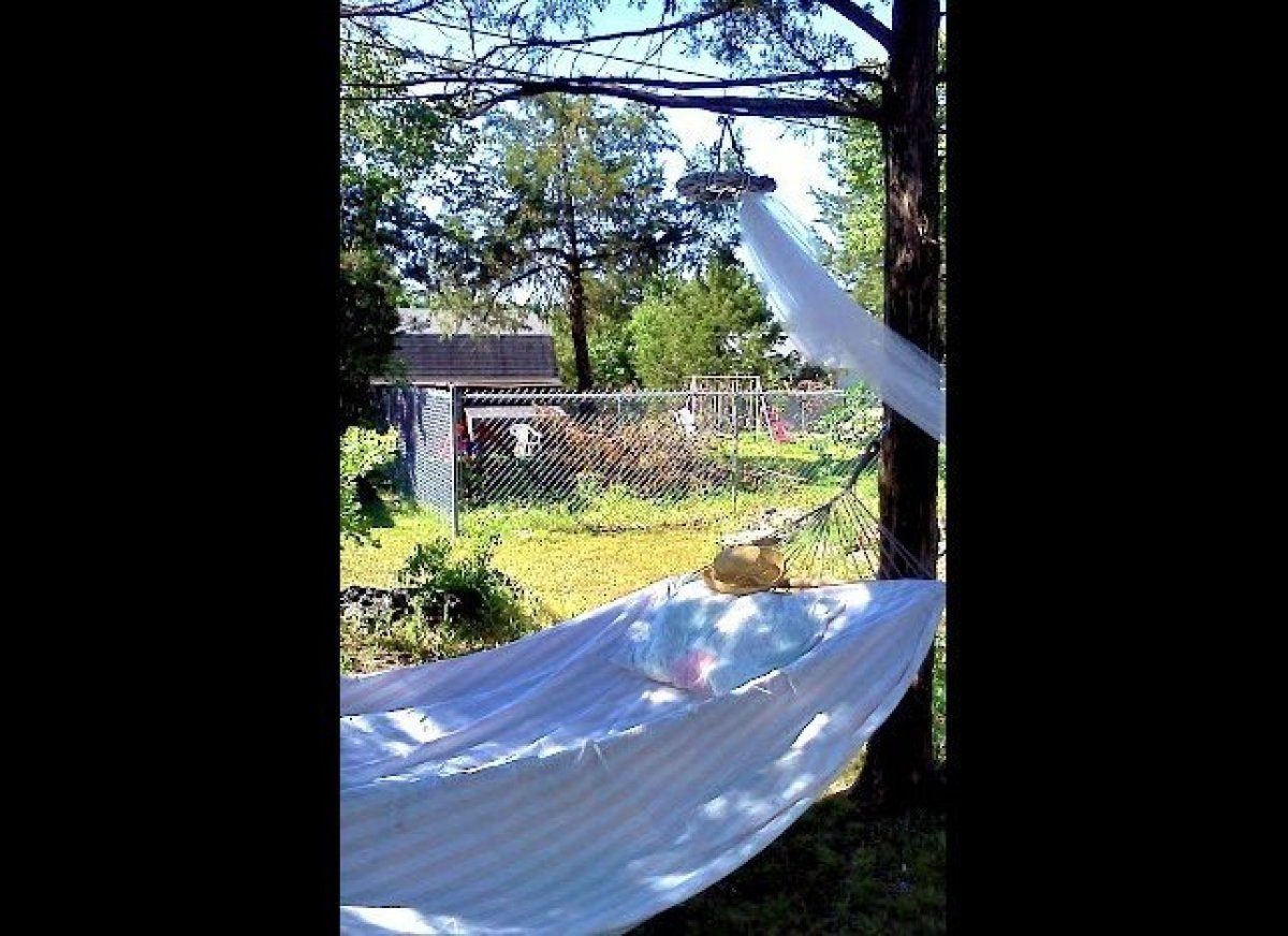 This hammock strung out in a shady spot beneath a tree provides a cool and comfy place for an afternoon nap. 
