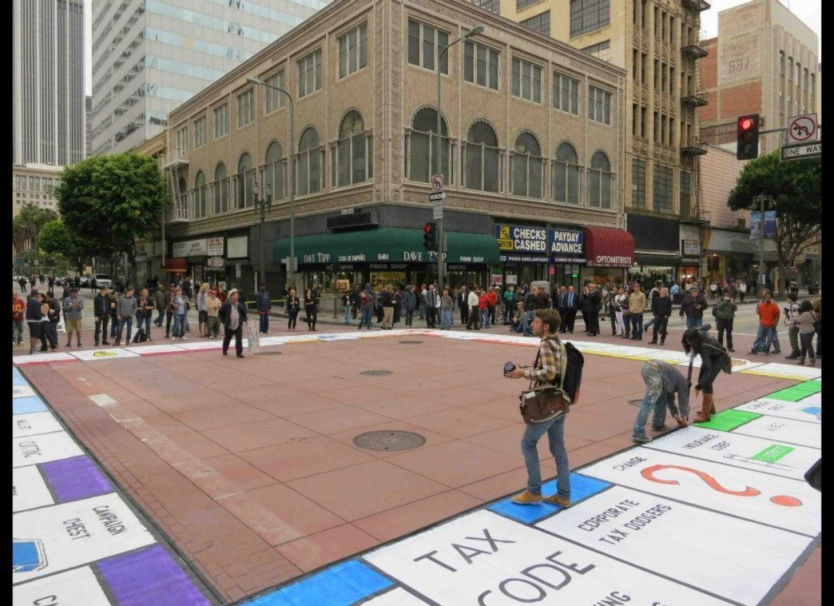 As the PAY 2 PLAY Board was unfurled and taped down, people took pictures and were reluctant to step on it at first.