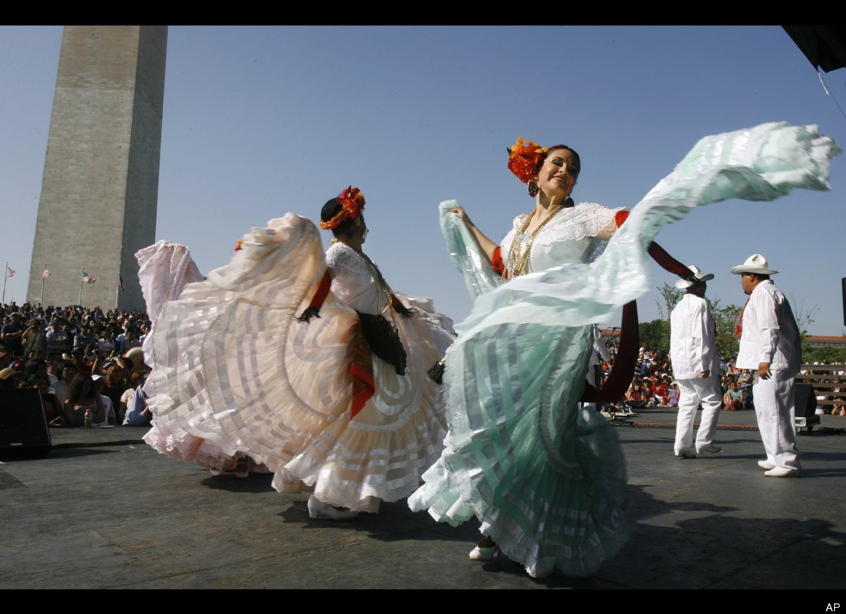 Karla Suarez, left, and Stella Clavijo, with the Maru Montero Dance Company, perform a Mexican folk dance at the 16th Nationa