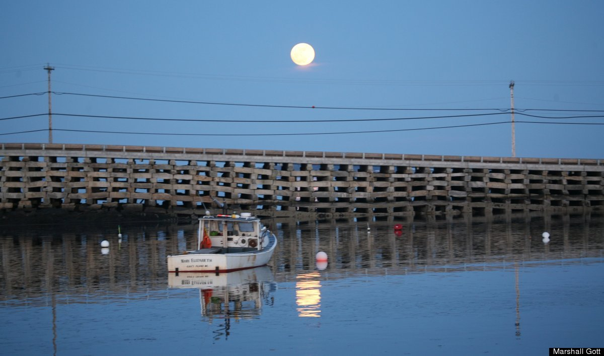View of the Bailey Island Cribstone Bridge and the supermoon.