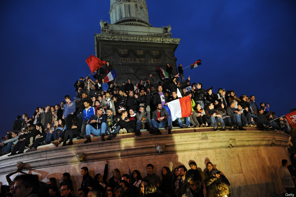 Supporters of Socialist Party (PS) candidate for the 2012 French presidential election celebrate at the Place de la Bastille