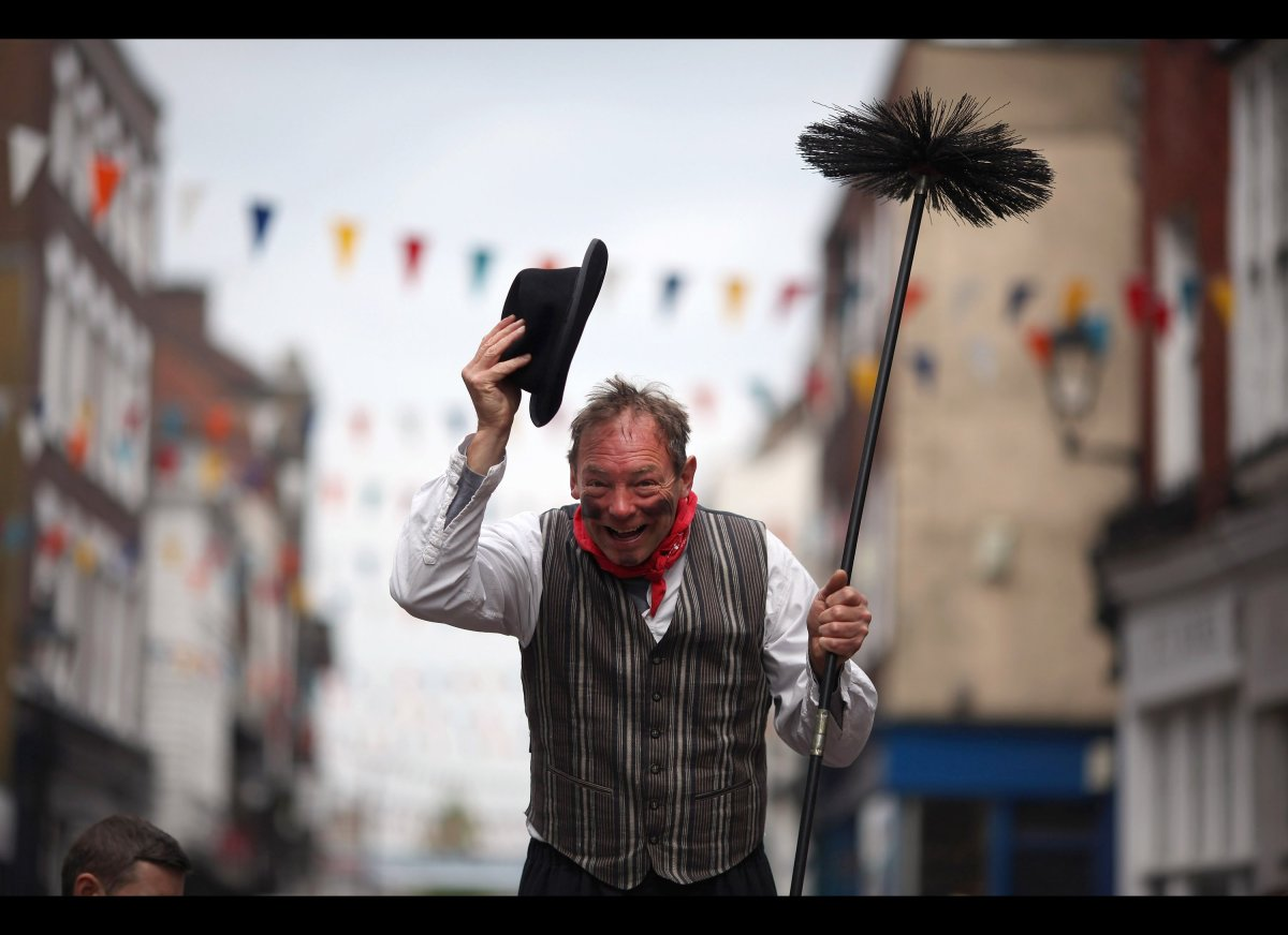 A man dressed as chimney sweep on stilts takes part in the annual Sweeps Festival on May 7, 2012 in Rochester, England. The t