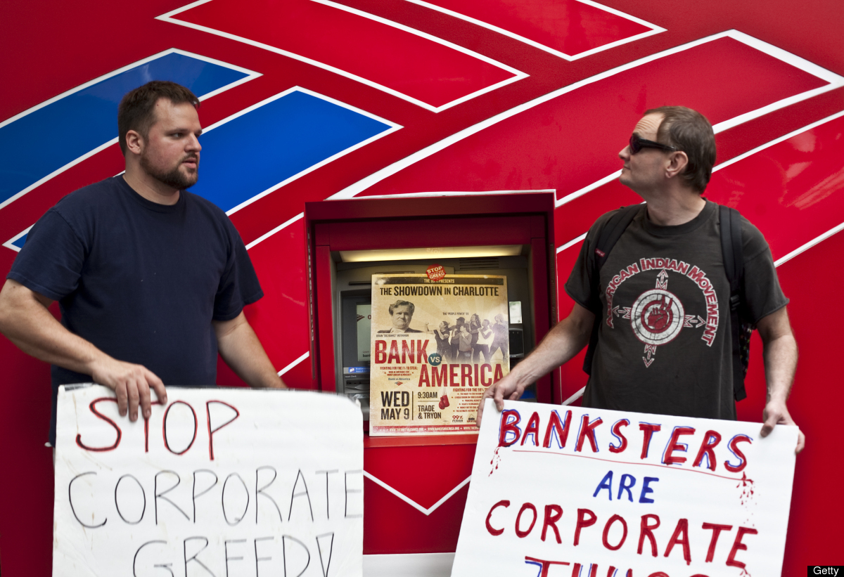 CHARLOTTE, NC - MAY 9: An activist shouts while protesting outside of the annual Bank of America Corp. shareholders meeting o