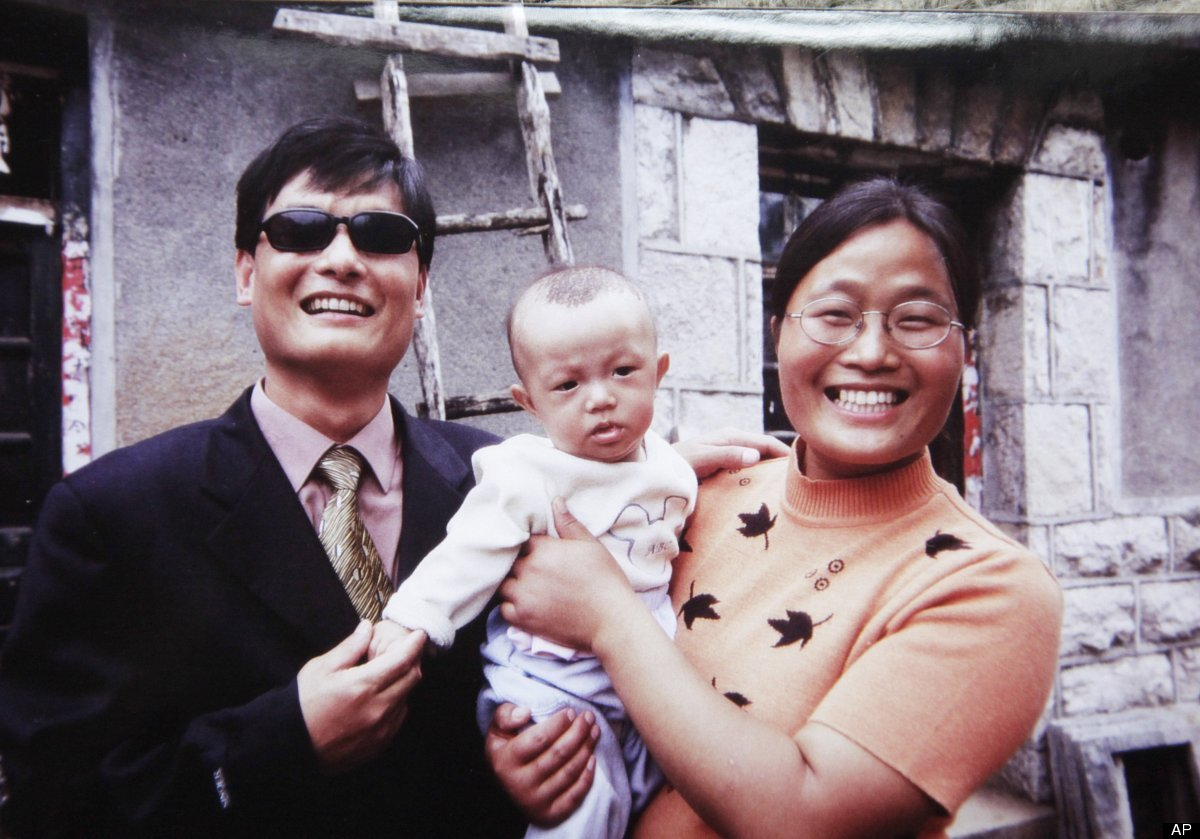 In this 2005 photo provided by Joan Lebold Cohen, Chinese legal activist Chen Guangcheng, left, and his wife, Yuan Weijing, h