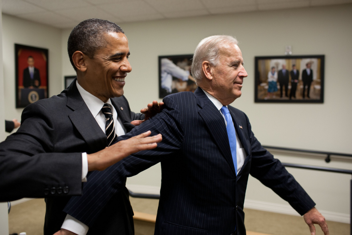 President Barack Obama jokes with Vice President Joe Biden backstage before the STOCK Act signing event in the Eisenhower Exe