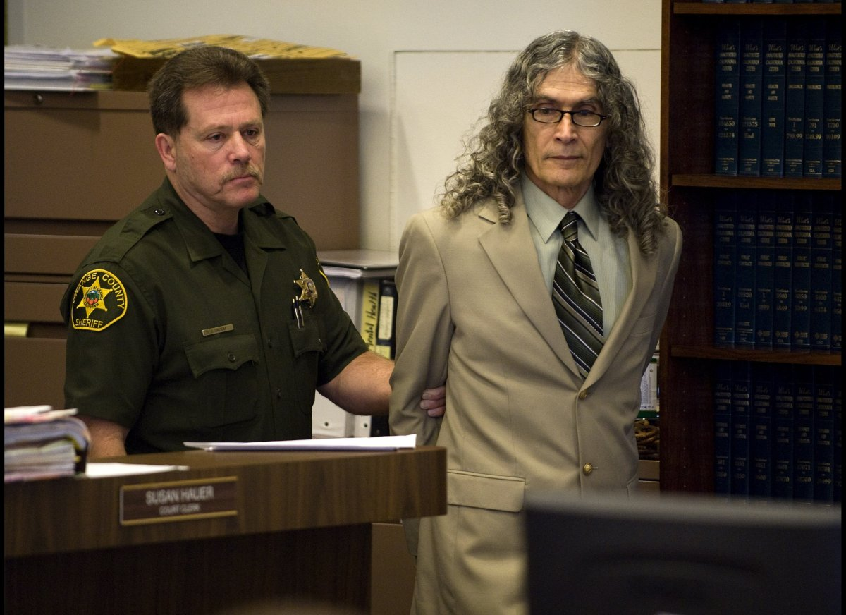 Serial murder suspect Rodney Alcala, right, enters the courtroom before the start of final arguments in his death penalty tri